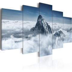 Artgeist Wandbild - Bergspitze über den Wolken