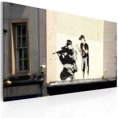 Artgeist Wandbild - Scharfschütze und Kind (Banksy)